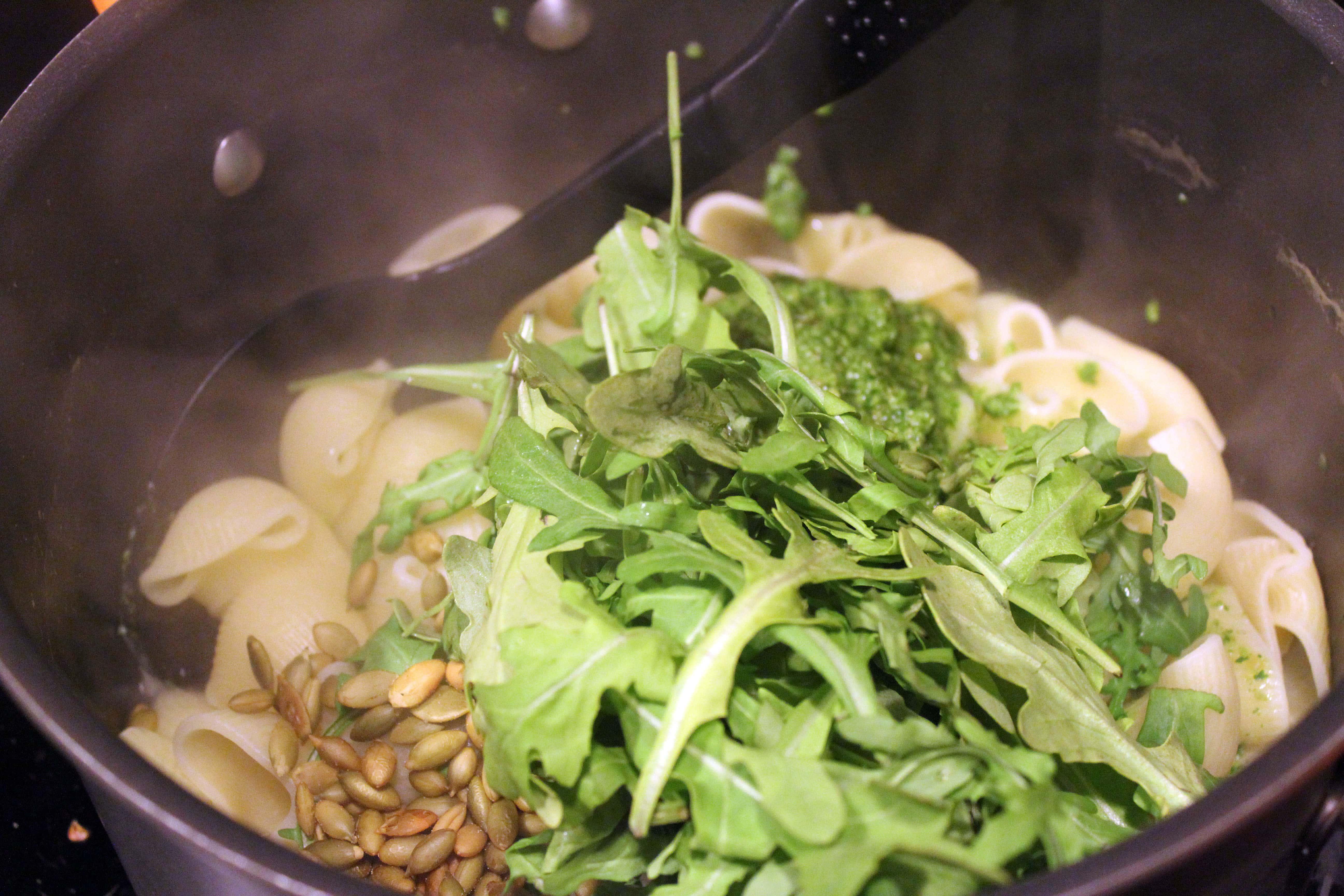 Add arugula and extra pepitas to pasta