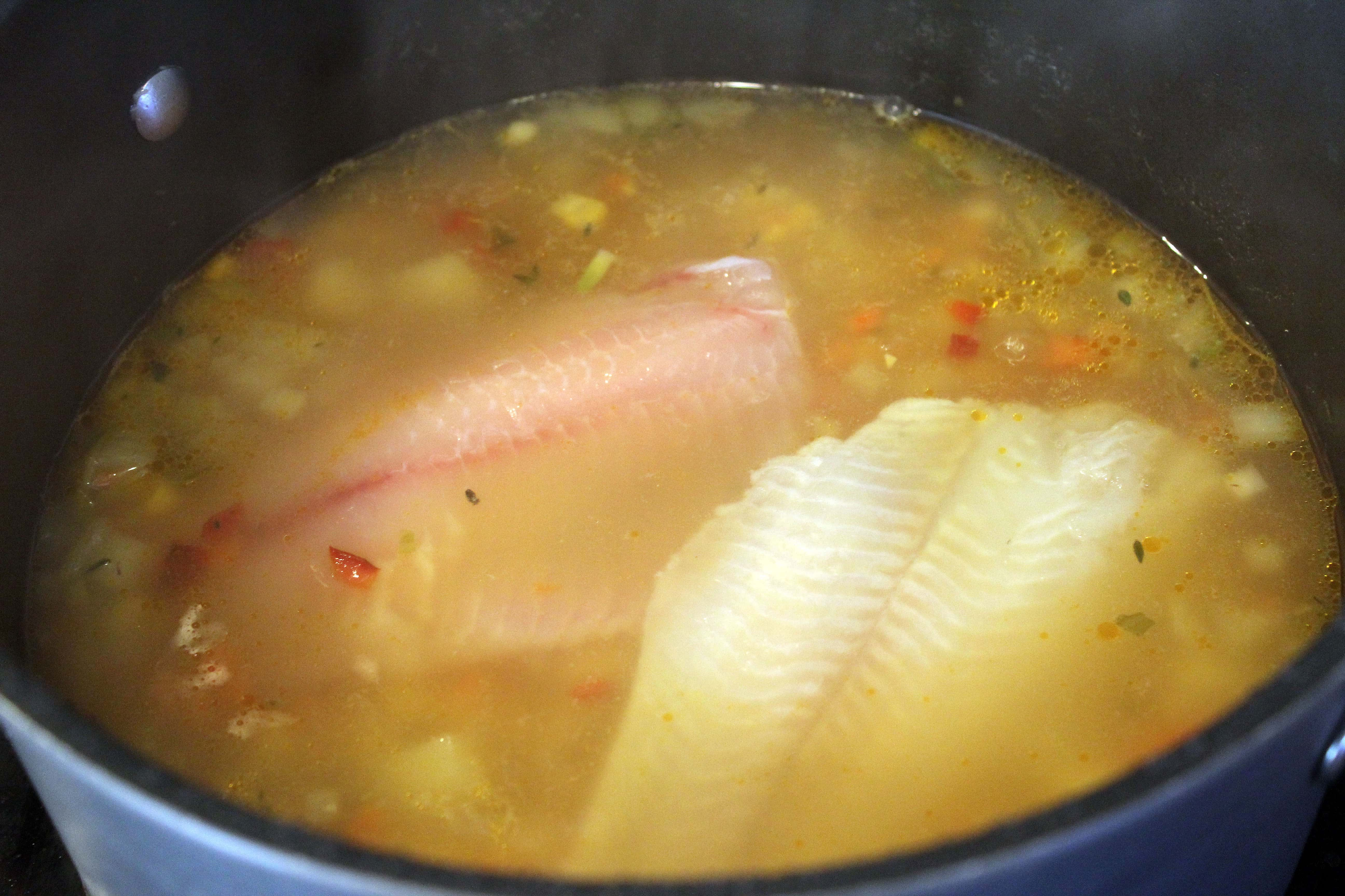 Add fish to cooked soup to let simmer