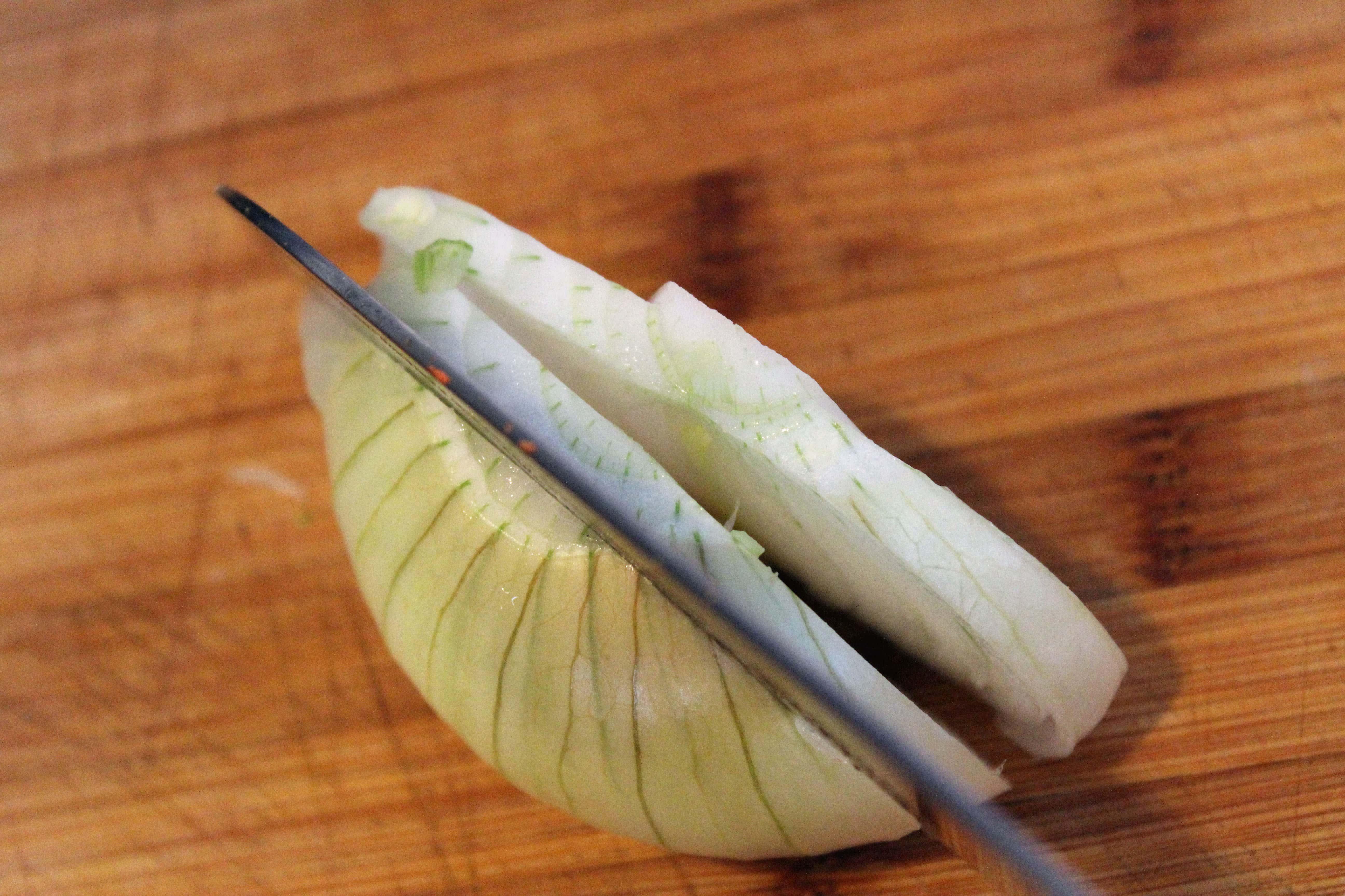 Cut onion half into planks