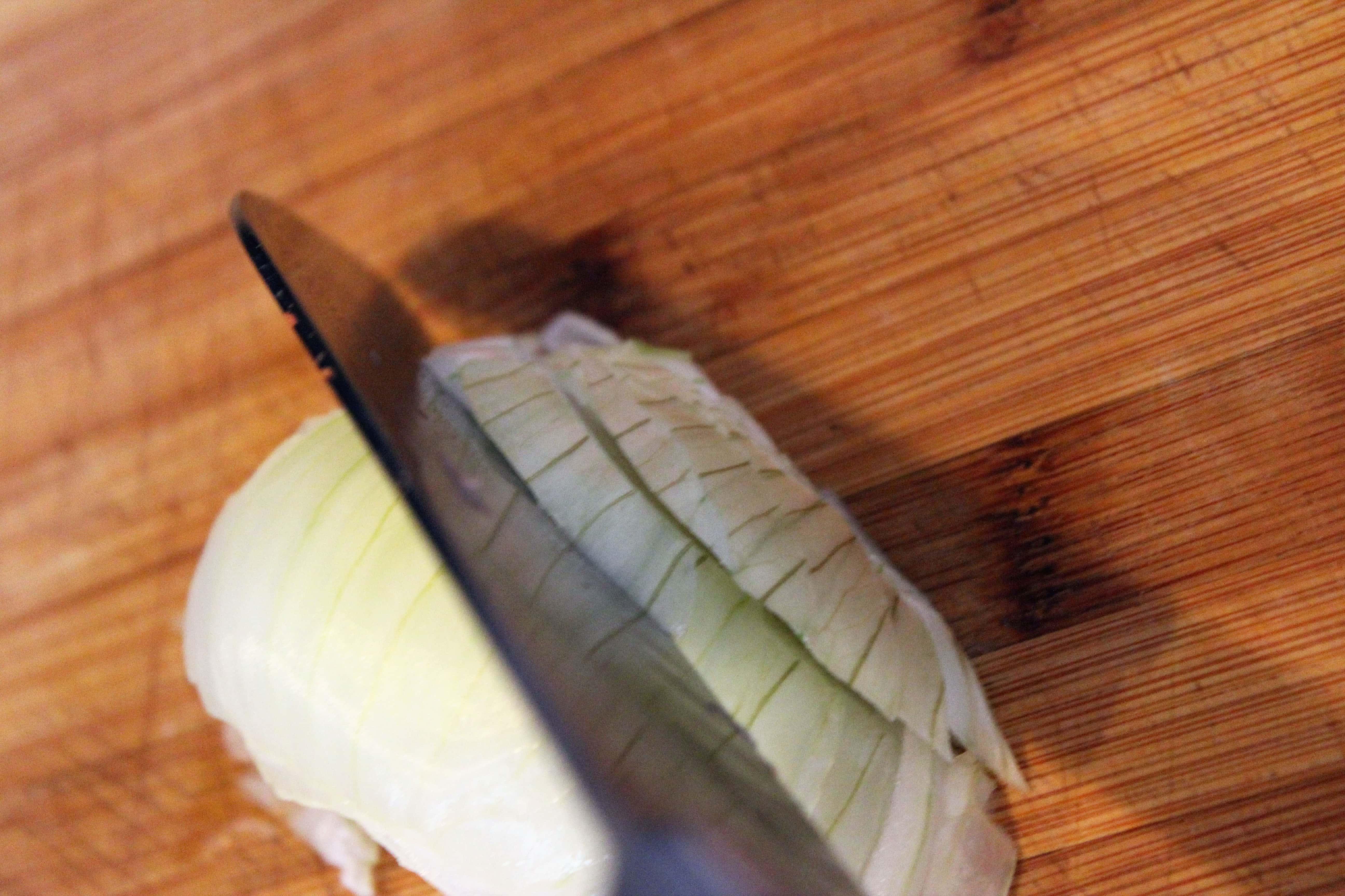 Cut onion planks into strips