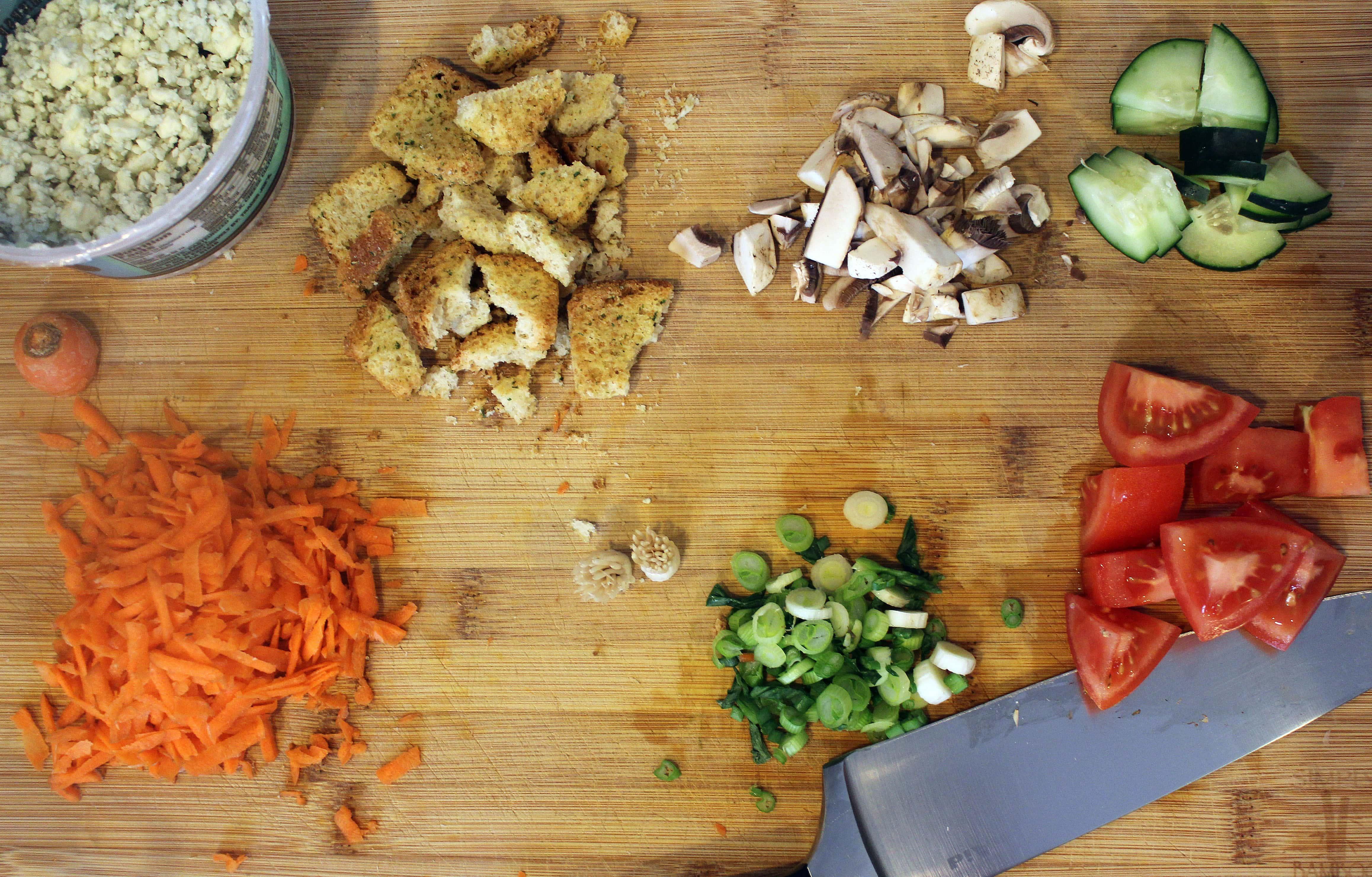 Prep veggies for salad building