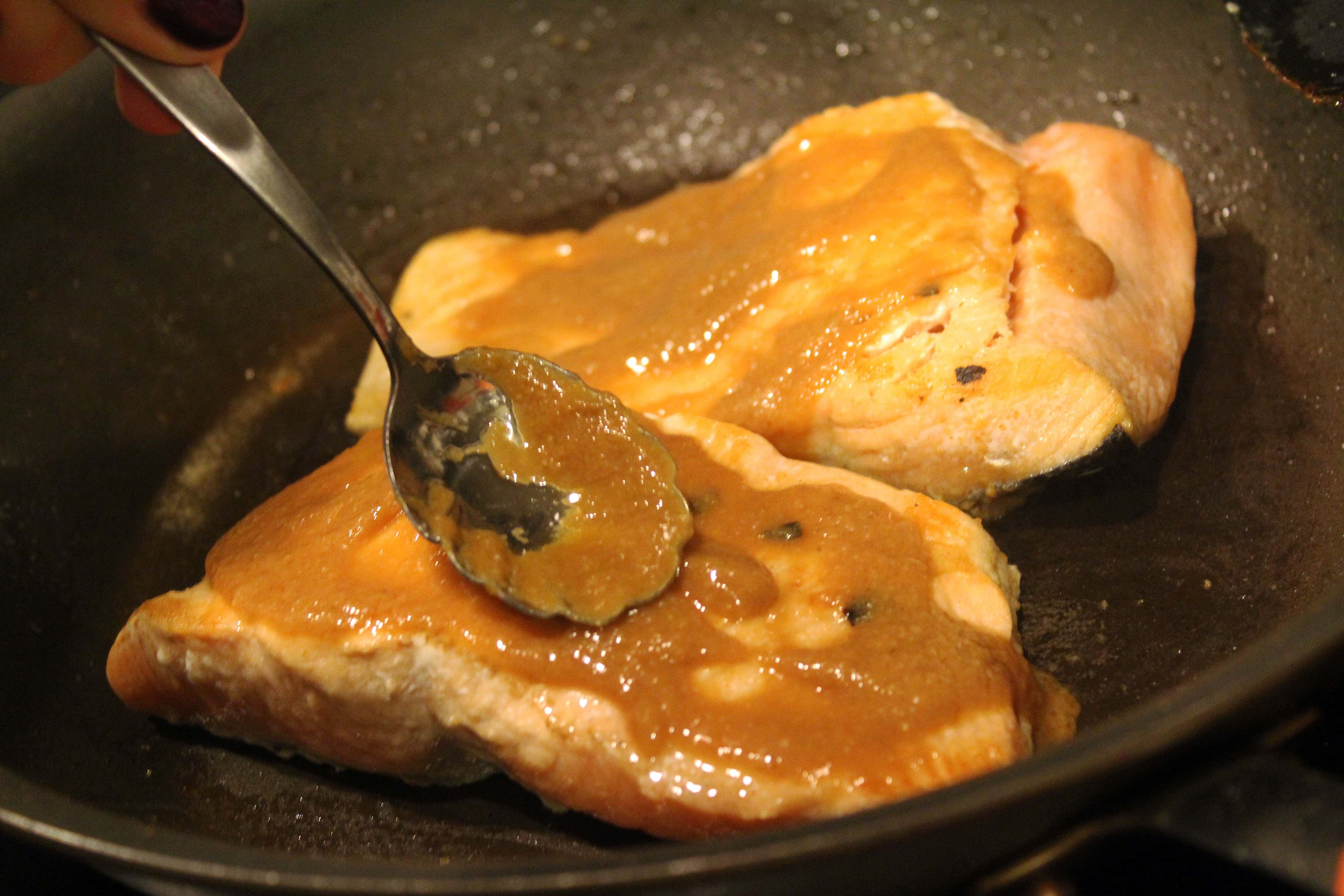 Spread sauce on top of salmon