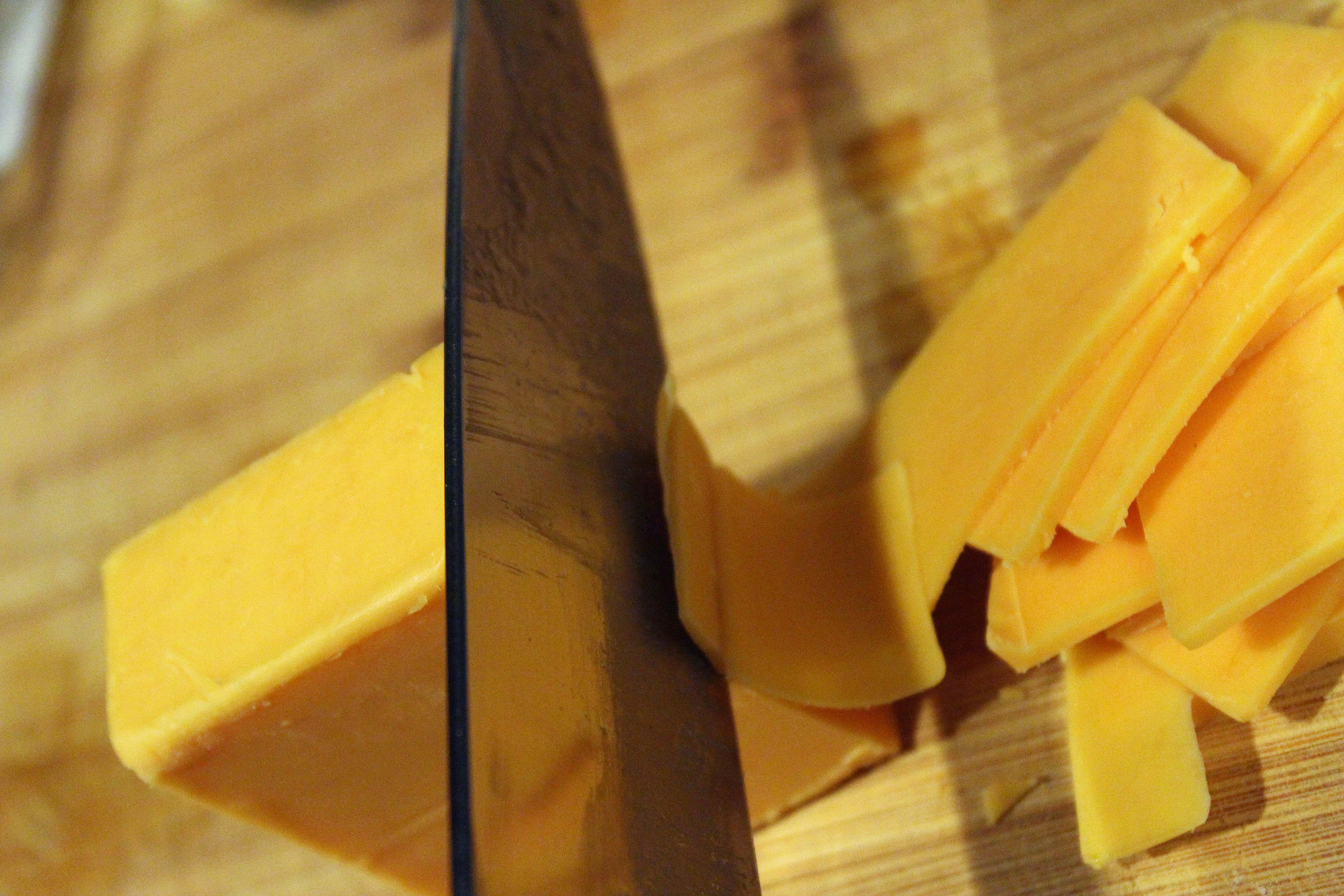 Thinly slice cheese