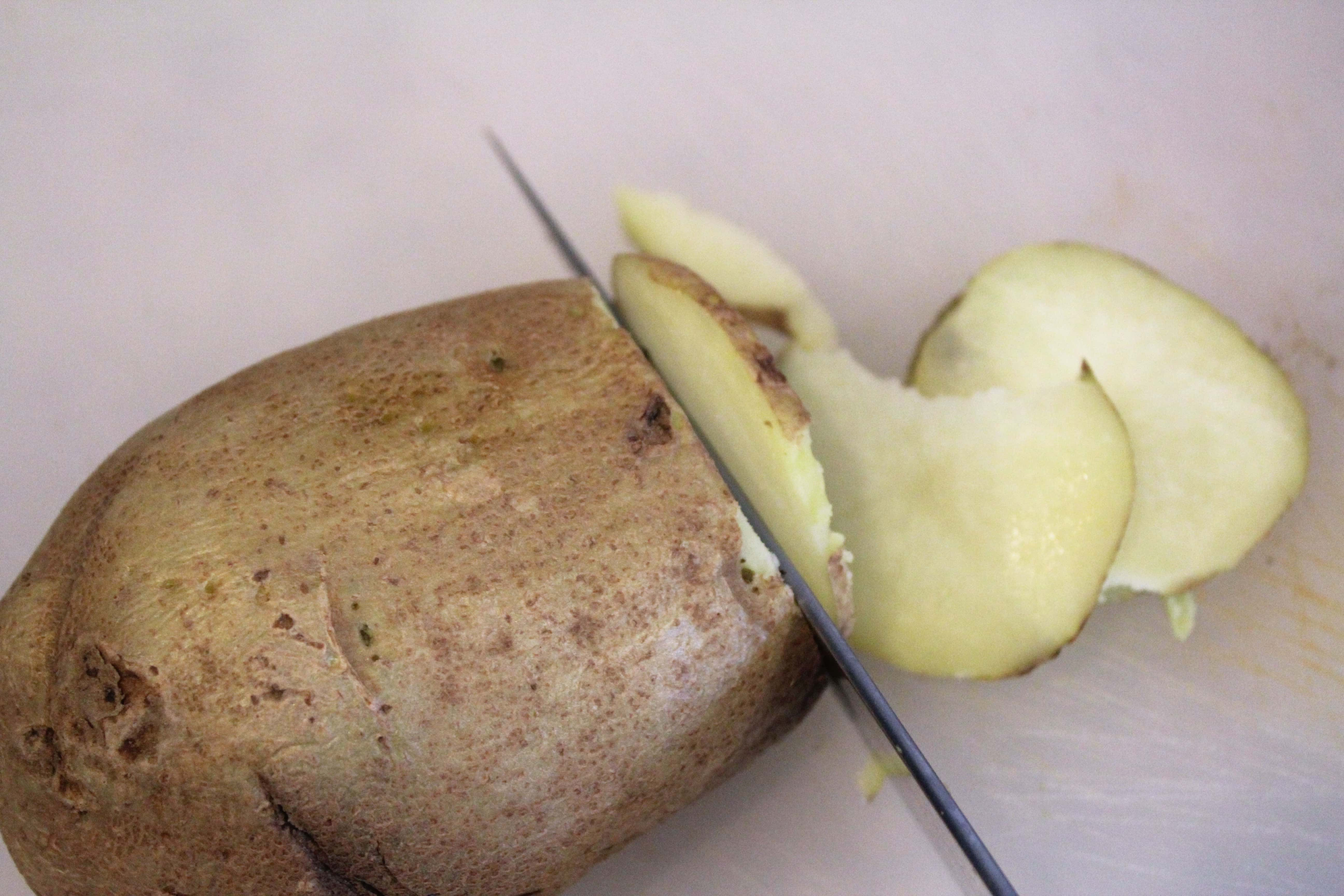 Thinly slice potato