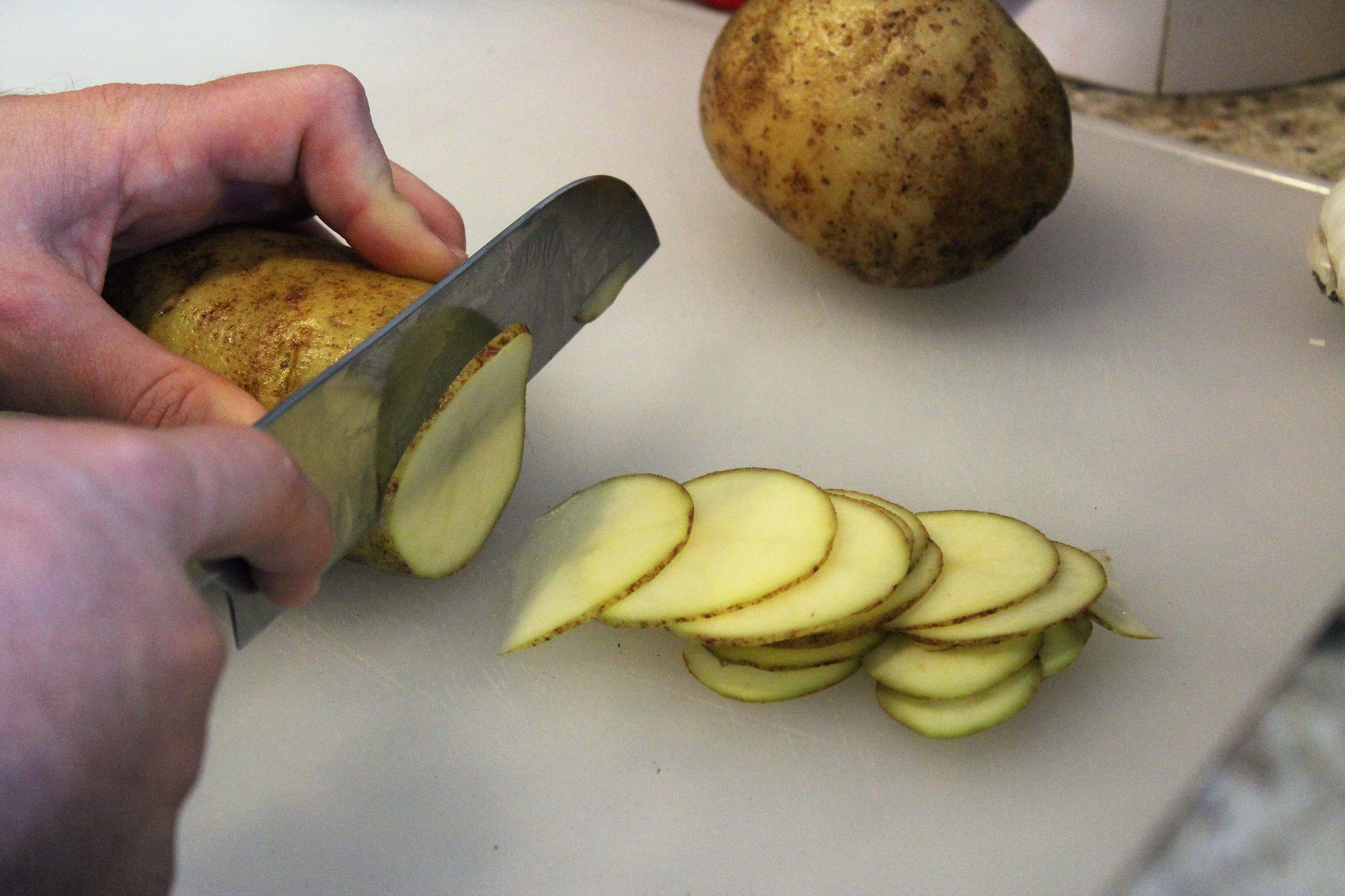 Thinly slice potato