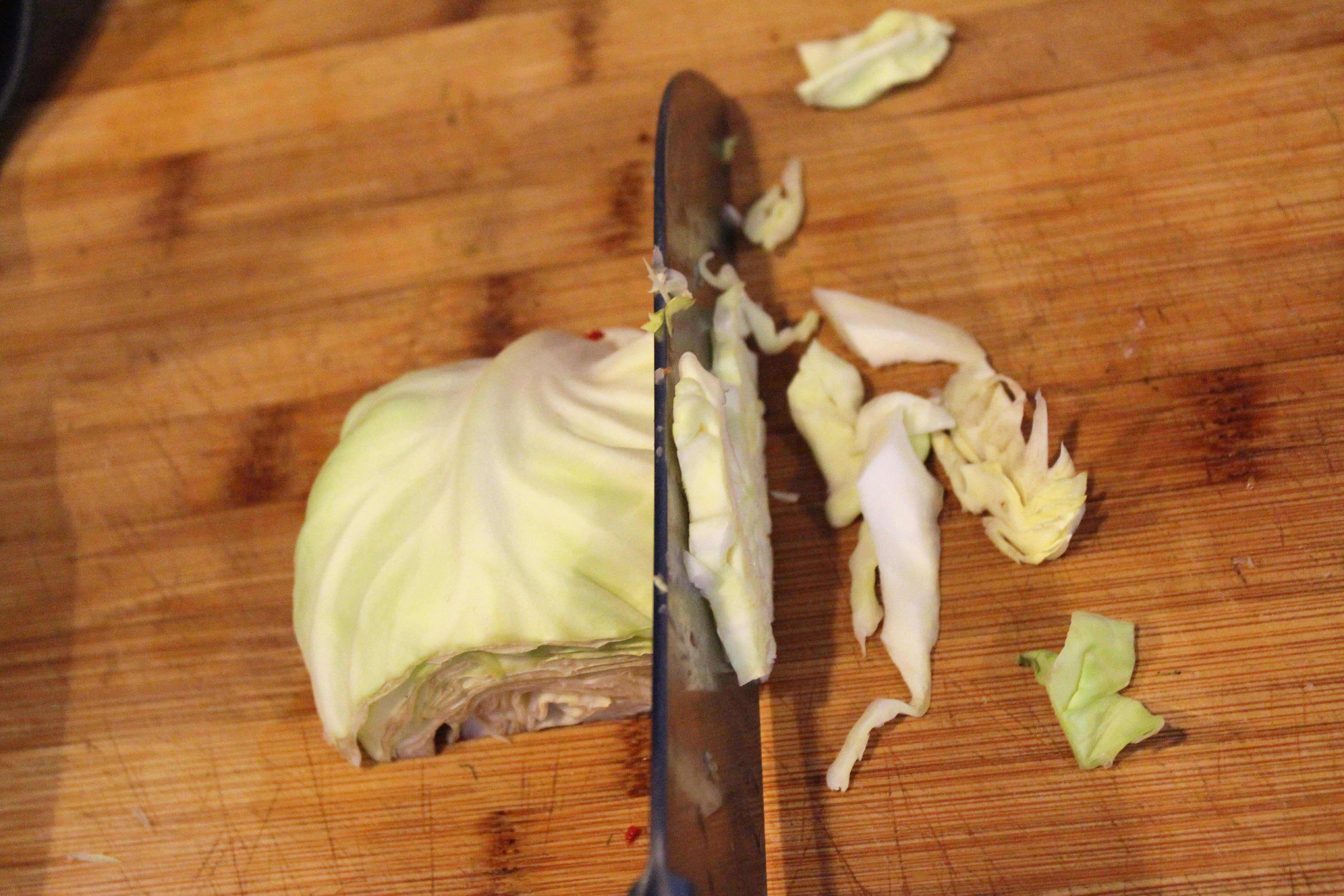 Thinly slice cabbage