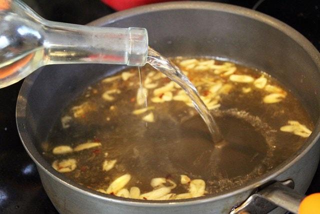 Add wine to garlic sauce