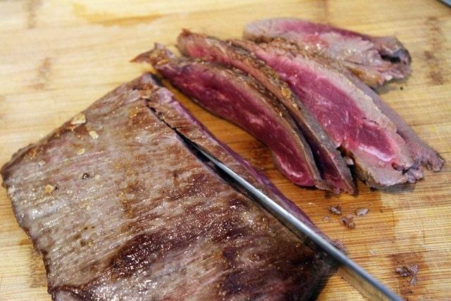 Thinly slice steak