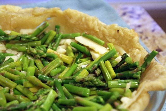 Place asparagus and cheese in crust first