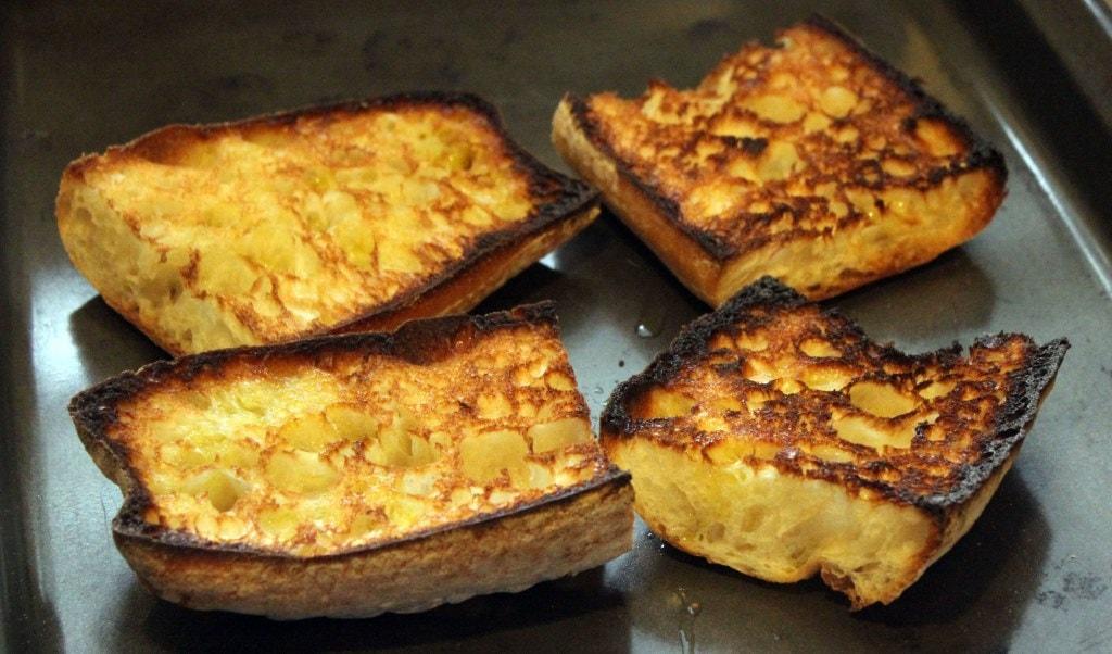 Broil bread until crispy