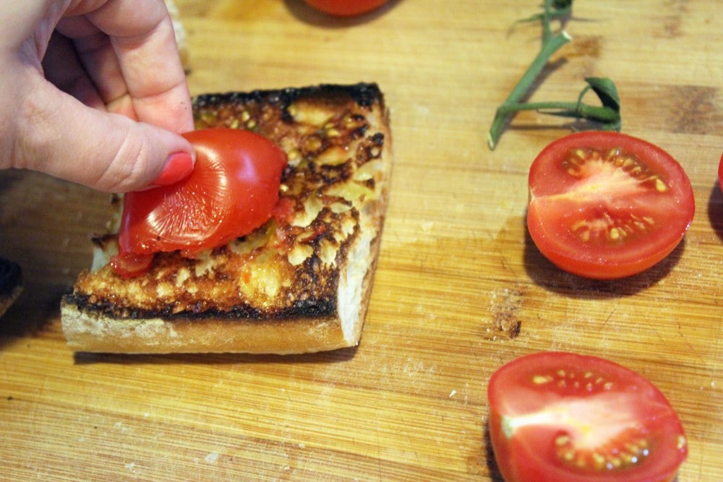 Rub toasted bread with tomato