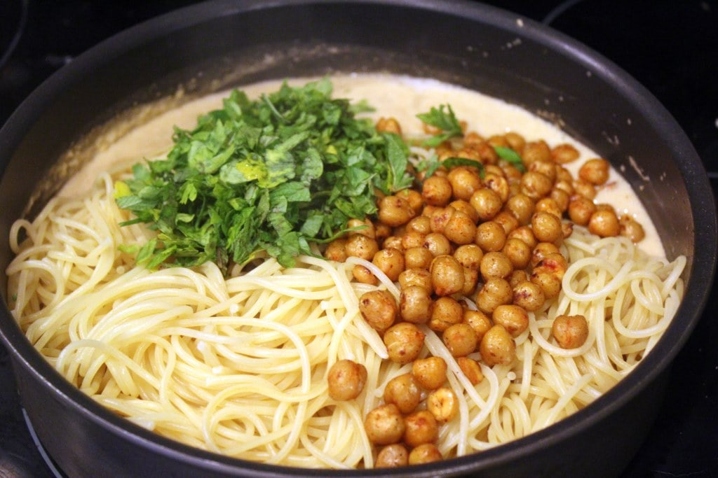 Toss chickpeas with herbs and sauce