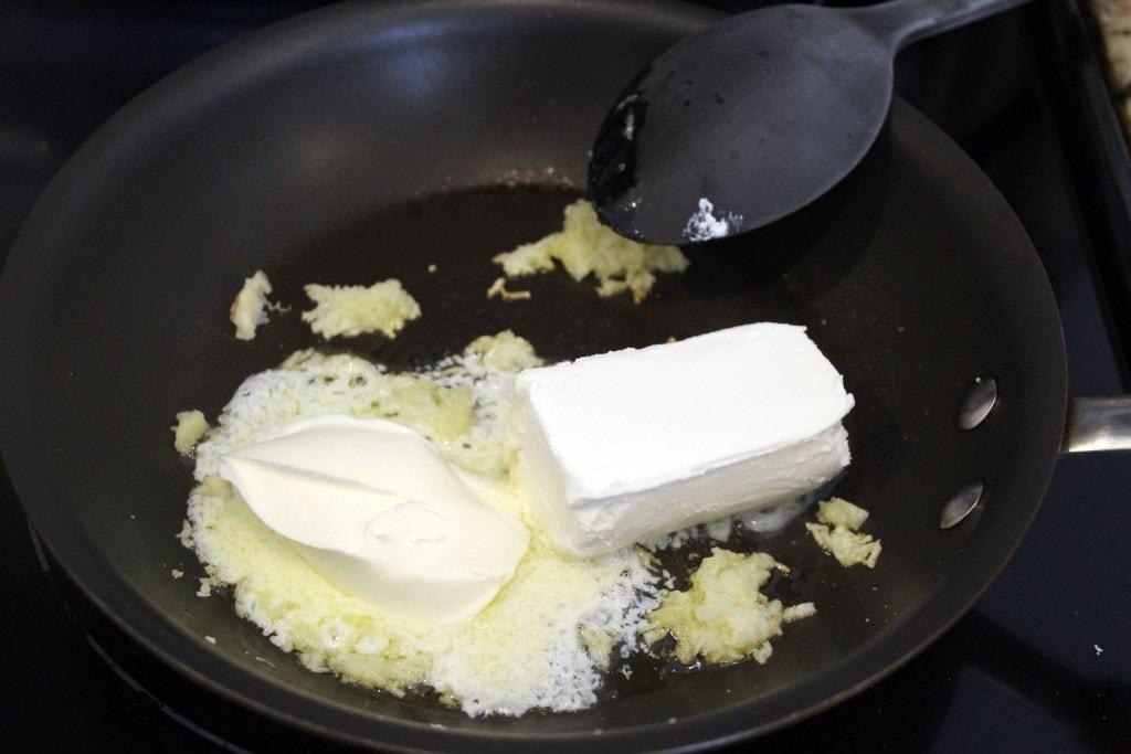 Add cheeses to garlic