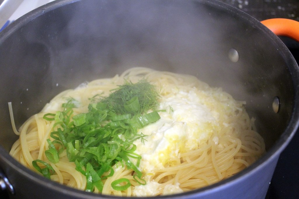 Add herbs with sauce to pasta