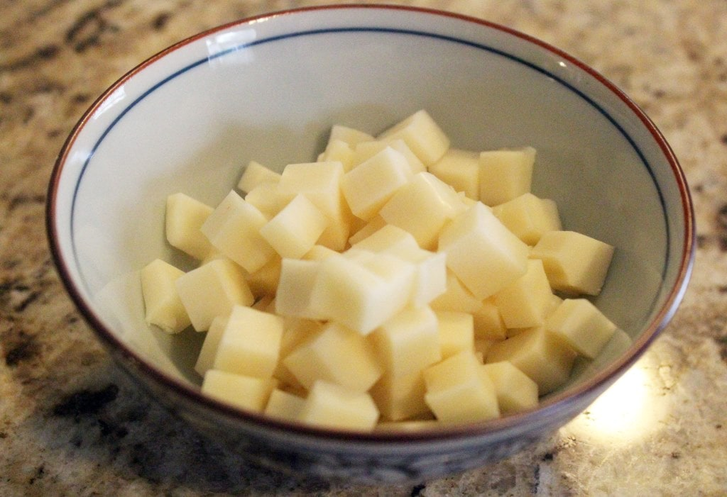 Cut cheese into little cubes