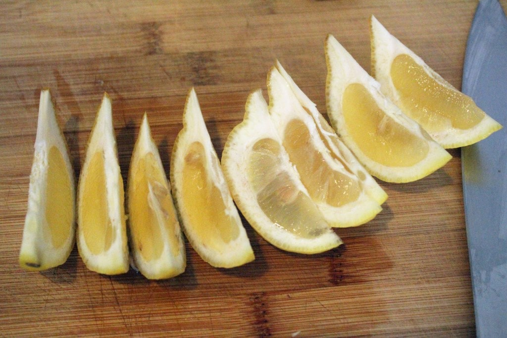 Cut second lemon into wedges