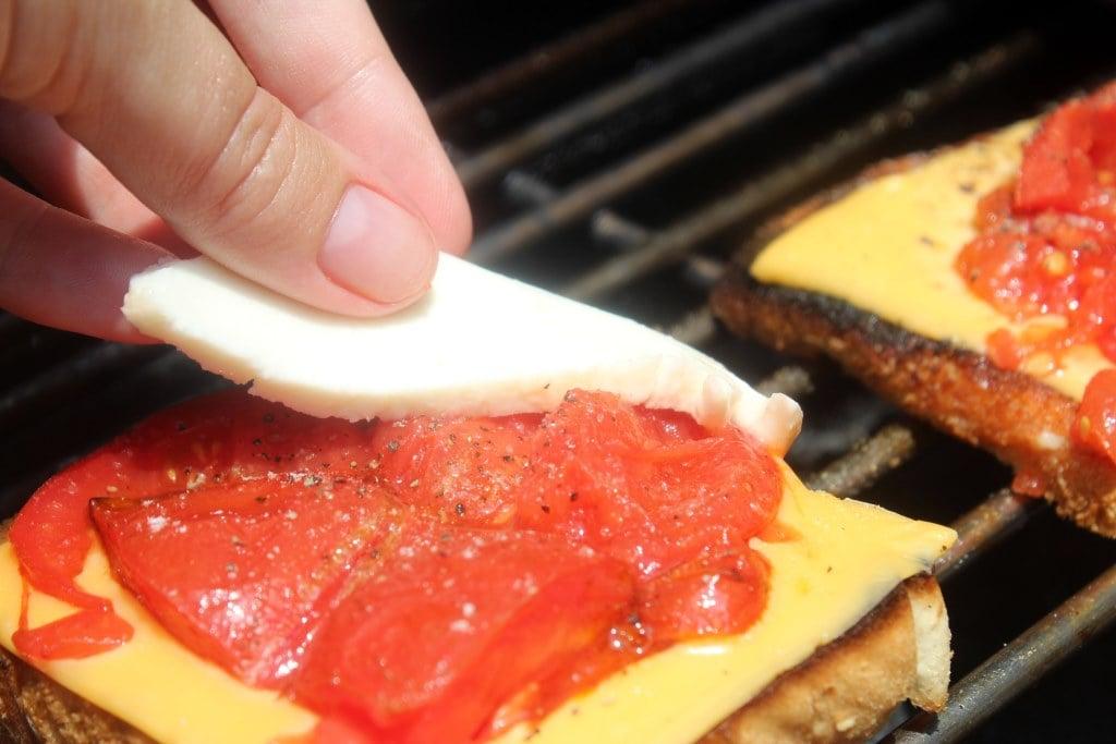 Lay mozzarella over tomato