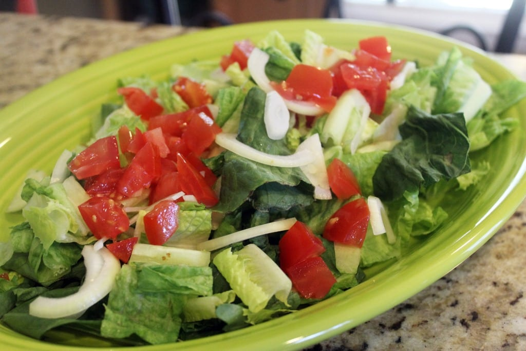 Add tomato and onion to lettuce
