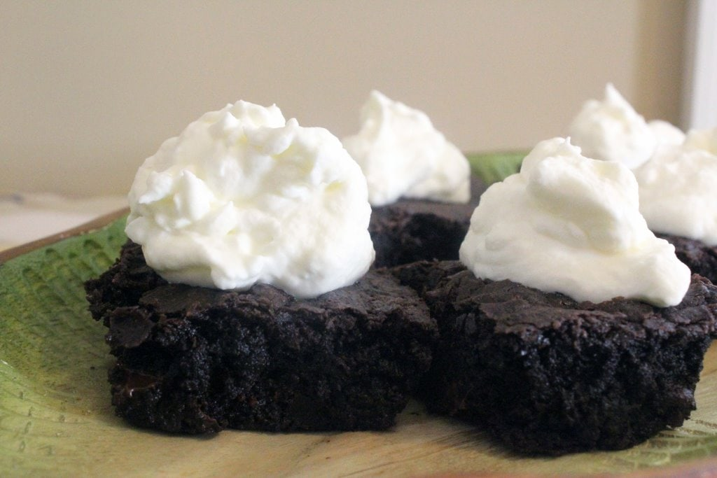 Brownie topped with cream