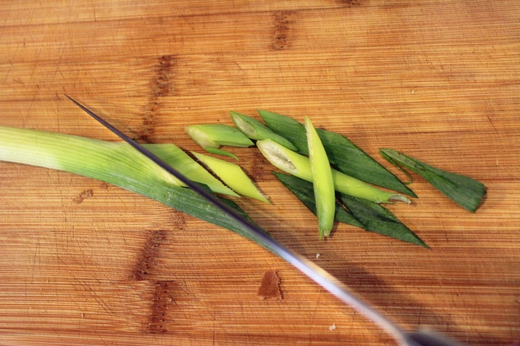 Thinly slice green onions