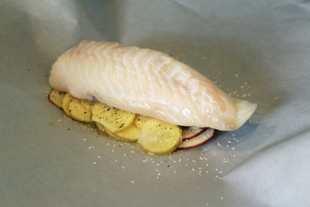 Add fish over potatoes