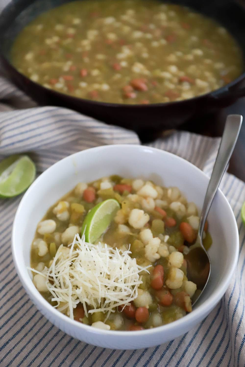 Posole verde with hominy, chilies, and salsa verde. From funnyloveblog.com, how to make posole verde for cinco de mayo.