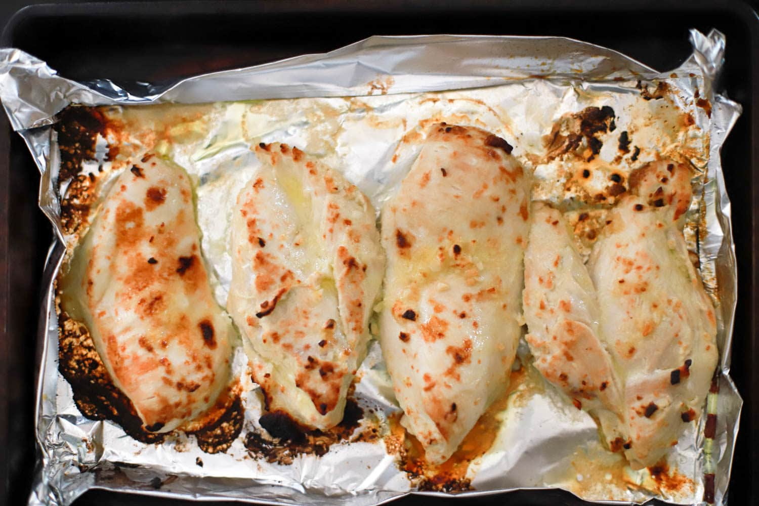 Lemon broiled chicken with basil sauce, gluten free and dairy free.