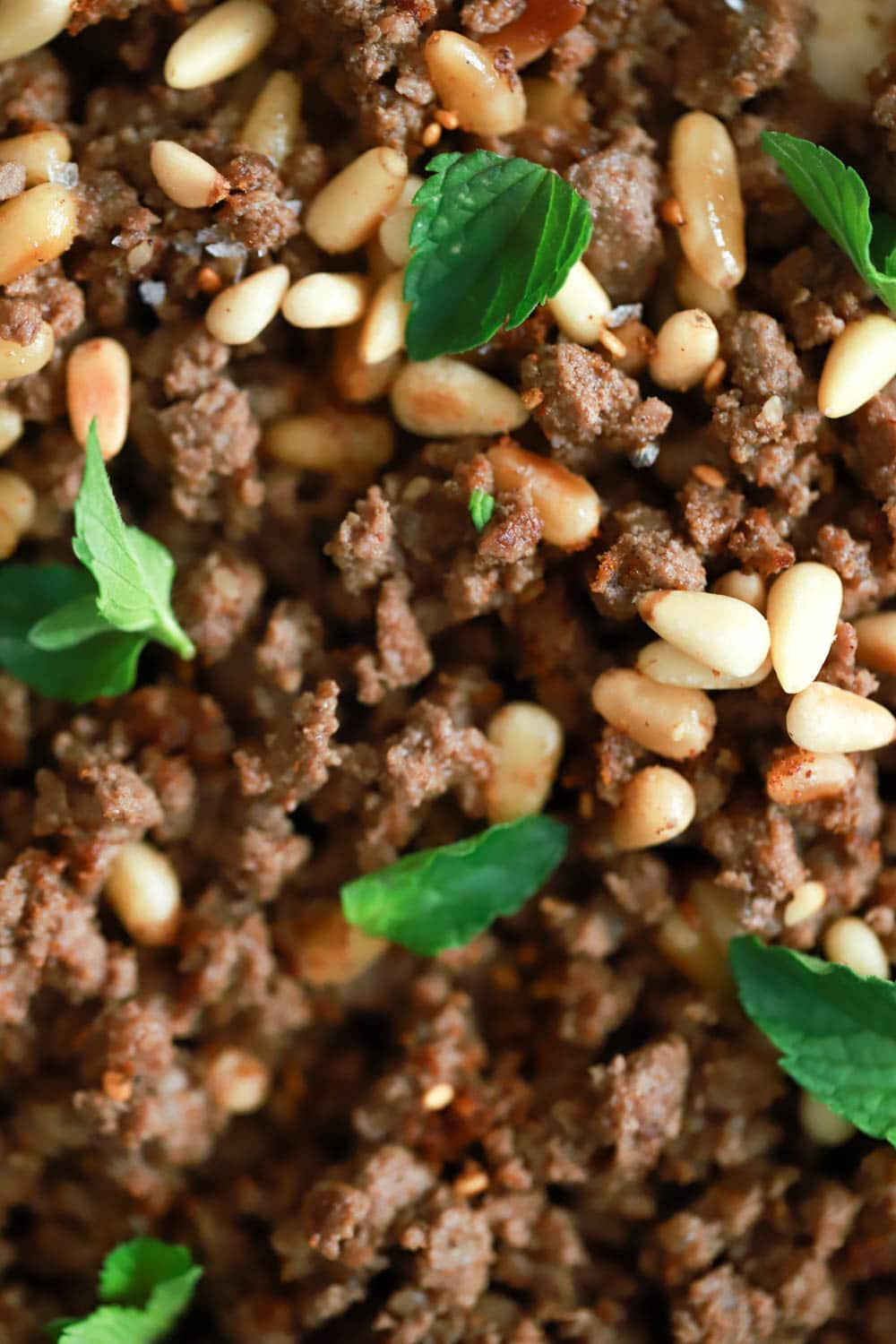Spiced Ground Meat with Pine Nuts over Hummus Recipe